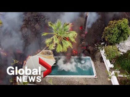 La Palma volcano: Drone video shows black lava swallowing pool, homes on its way to coast